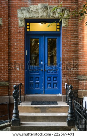 a blue door on an apartment building - stock photo