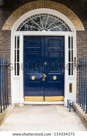 A Blue door with arched glass panels - stock photo