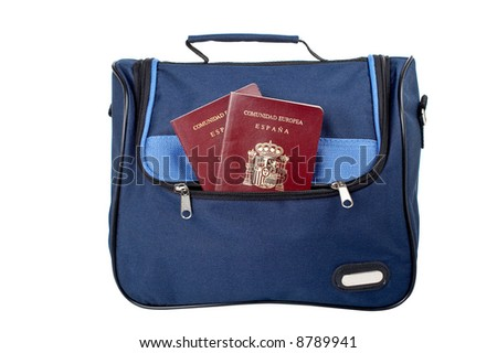 A blue handbag with two spanish passports, isolated on white background