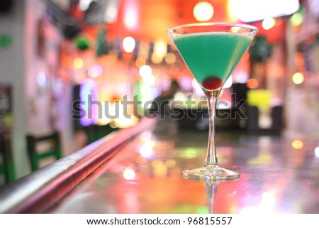 A Blue Hawaiian cocktail at a bar. - stock photo
