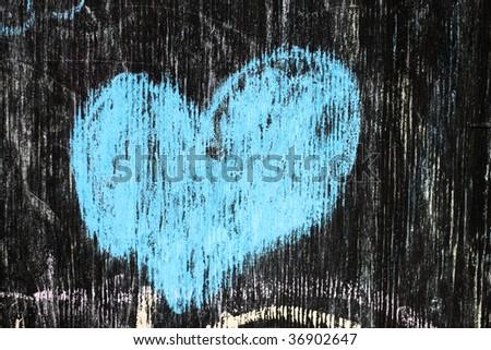 a blue heart in chalk on a blackboard - stock photo