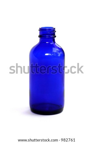 A blue homeopathic medicine bottle. - stock photo
