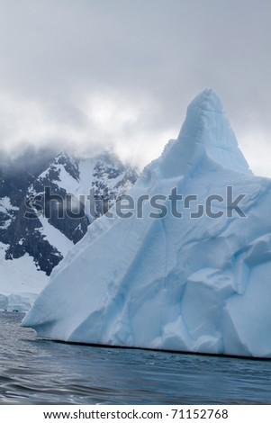 A blue iceberg in antarctica - stock photo