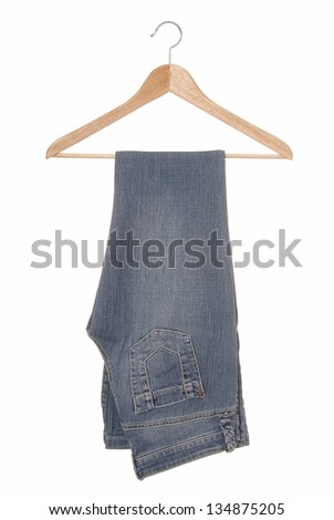 A blue jeans are on hanger. - stock photo