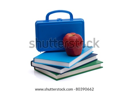 A blue lunchbox with an apple and books isolated on white, Healthy School Lunch - stock photo
