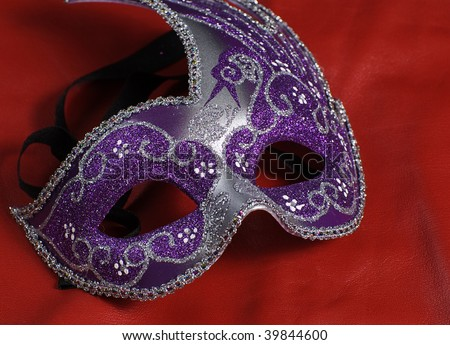 A blue mask shot against a red background - stock photo