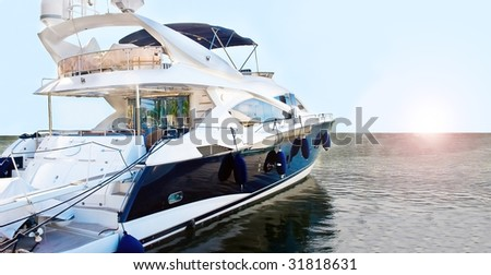 A blue moored motorboat waiting for sailing. - stock photo