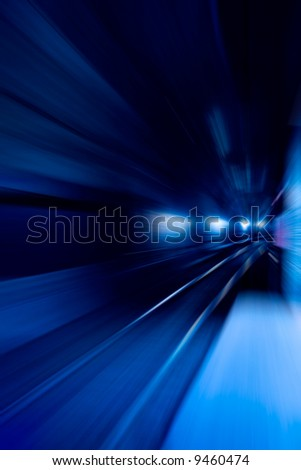 A blue motion concept image - moving train - stock photo