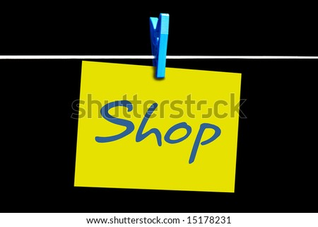 A blue peg holding a yellow shop sticky