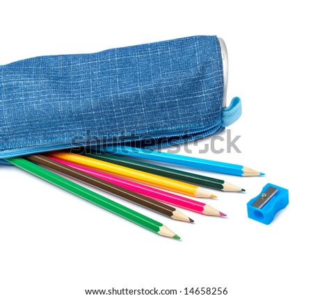 A blue pencil case with school supplies on white background. Shallow depth of field - stock photo