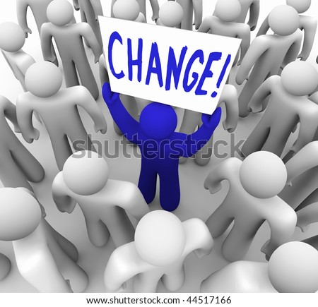 A blue person stands out in a crowd holding a sign reading Change - stock photo
