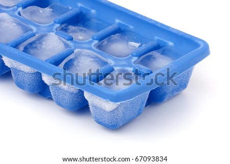 A blue plastic ice cube tray with frost on it isolated over a white background. - stock photo