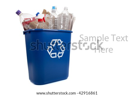 A blue recycle can with plastic bottles and paper on a white background with copy space - stock photo