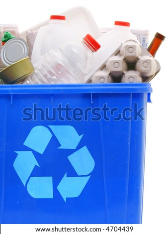 a blue recycling bin full of recyclable things - bottles, containers, newspapers, cans - stock photo