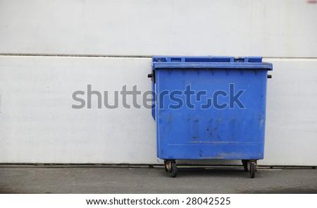 a blue refuse bin. street scene - stock photo