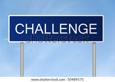 A blue road sign with white text saying Challenge