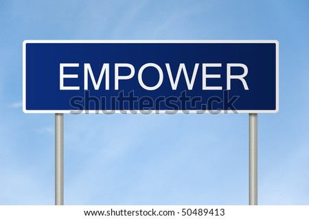 A blue road sign with white text saying Empower - stock photo