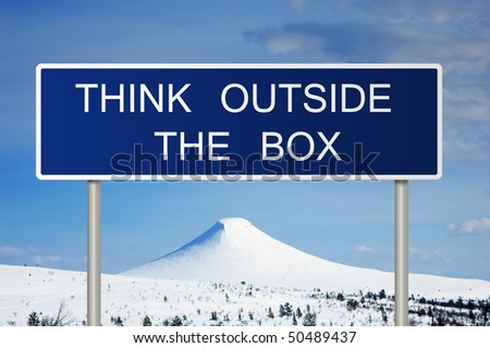 A blue road sign with white text saying think outside the box - stock photo