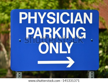 A blue sign that reads Physician Parking Only - stock photo