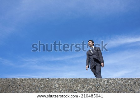A blue sky and a business man