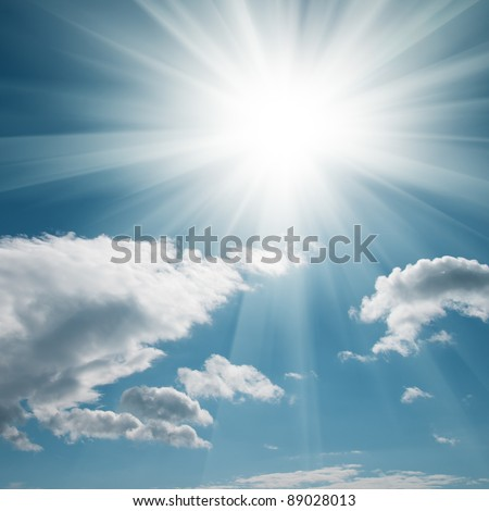 A blue sky with clouds and bright sun - stock photo