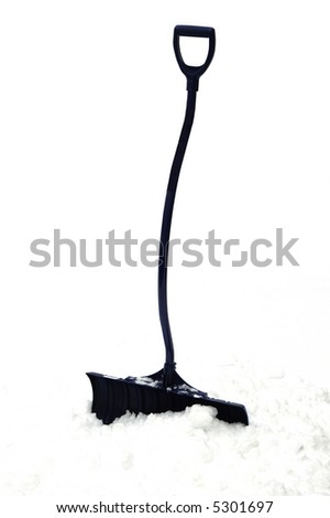 A blue snow showel burried in heavy snow - stock photo