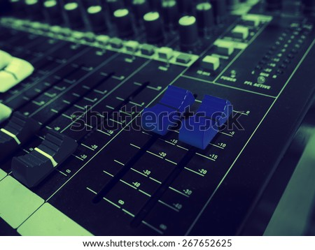 A blue sound mixer buttons control with black and white  sound mixer buttons in vintage style. - stock photo