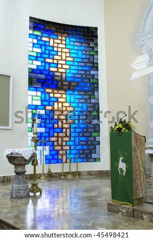 A Blue Stained Glass Window at a Church Altar - stock photo