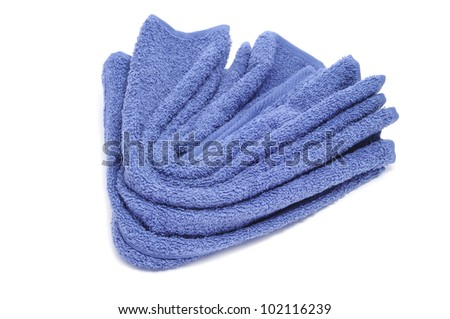 a blue towel on a white background - stock photo