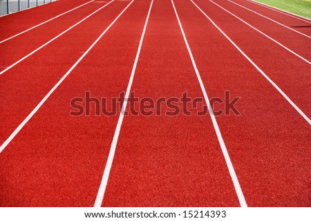 A blue track at a High School - stock photo