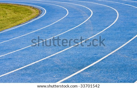 A blue track for running events showing lanes