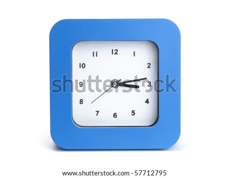 A blue wall clocks on white ground - stock photo