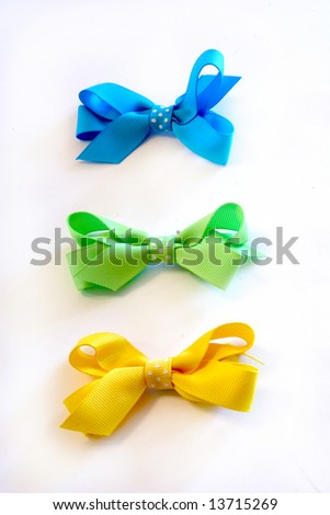a blue, yellow, and green bow isolated on white - stock photo
