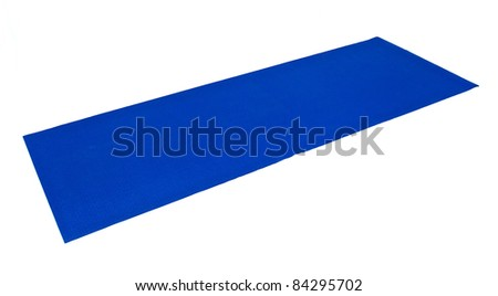 A blue yoga exercise mat is laid out flat and ready to use against white. - stock photo