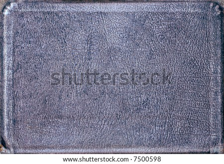A blueish piece of leather shaped as a book-cover, suitable as a background or texture. - stock photo