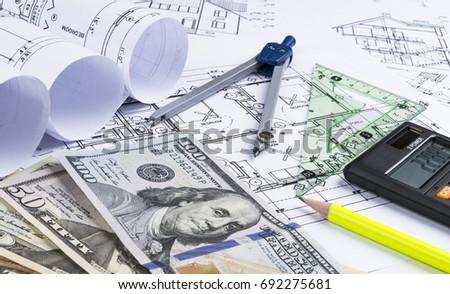 Blueprint architect money calculator symbolic photo stock photo a blueprint of an architect with money calculator symbolic photo for financing and planning malvernweather Images