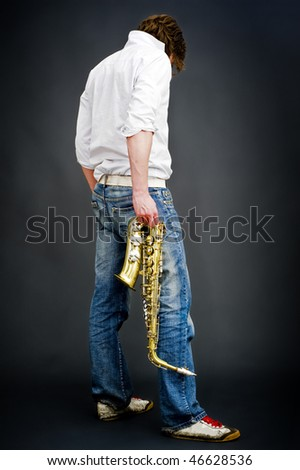 A blues musician enacting the lifestyle - stock photo