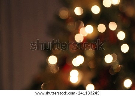 A blurred Christmas tree with white lights.  - stock photo