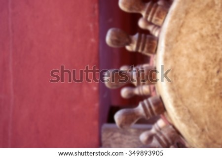A blurred picture of ancient  northern Thai drums in Buddhist temple at Chiang Rai, Thailand - stock photo