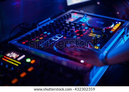 A blurred purple DJ working on his turntables