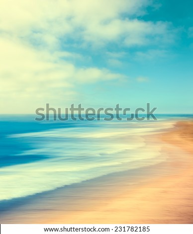 A blurred seascape abstract made with panning motion and long exposure.  Image displays soft, pastel colors in a retro style. - stock photo
