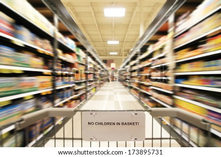 a blurred shot of an isle in a supermarket or grocery store shop - stock photo