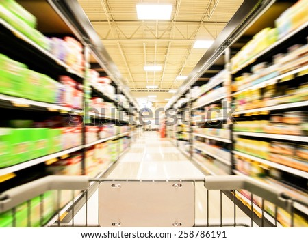 a blurred shot of an isle in a supermarket or grocery store shopping center - stock photo