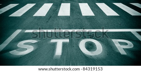 a blurry stop traffic sign in a road - stock photo