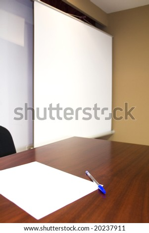 a board, a table, a paper and a pencil. office scene. - stock photo