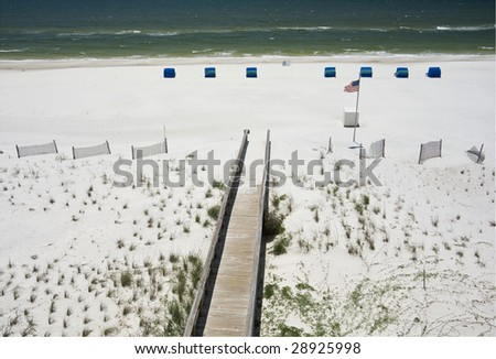 A boardwalk leading to the beach in Gulf Shores - stock photo