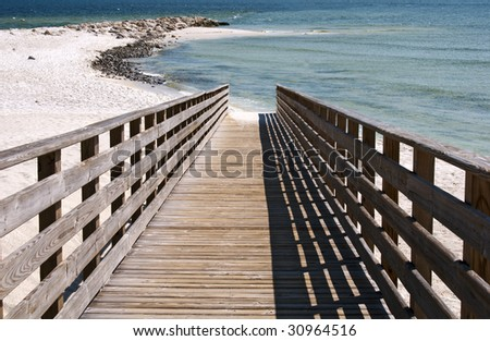 A boardwalk leading to the beach on the Alabama gulf coast. - stock photo