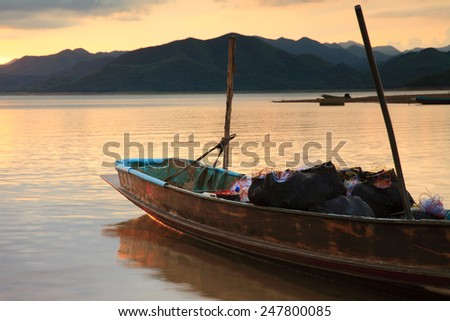 a boat / a fishing boat / boat - stock photo