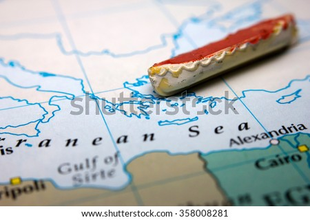 A boat and a map of Europe representing the immigration from the East - stock photo