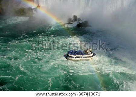 A boat at Niagara Falls - stock photo